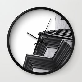 buildings in the city in black and white Wall Clock