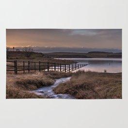 Still waters at the Derwent Reservoir at sunset Rug
