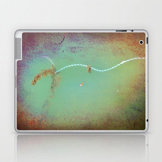 Rope floating in water Laptop & iPad Skin