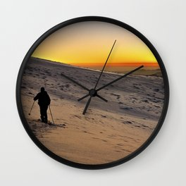 Mountaineer at sunset Wall Clock