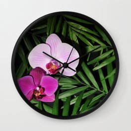 Orchids with palm leaves Wall Clock