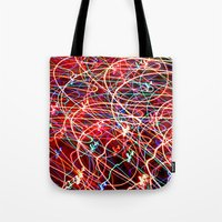 the lights Tote Bags featuring Lights by Serena Gailey