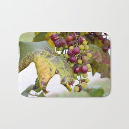 Green and purple grapes on the vine Bath Mat