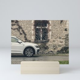 Modern car (Tiguan) in front of an old rustic manor Mini Art Print