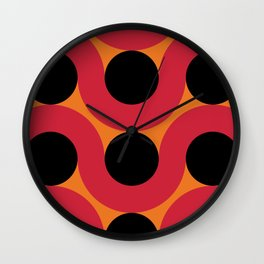 Black Balls on red Elastic Worms in an Orange Background Wall Clock
