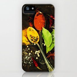 Bright spices on an old  wooden board iPhone Case