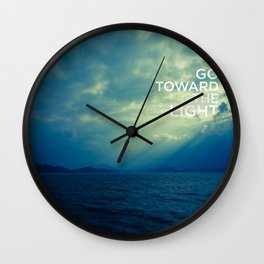 Go toward the light Wall Clock