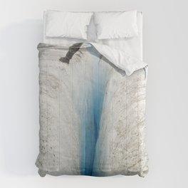 Don't Slip! Alaskan Glacier's Dangerous, Deep Crevasse Comforters