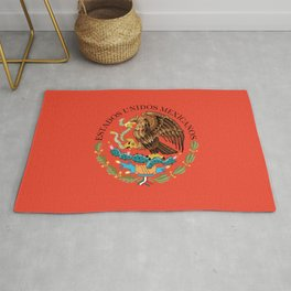 Close up of the Seal from the flag of Mexico on Adobe red background Rug