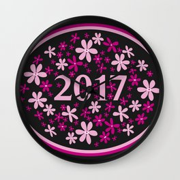 2017 year illustration decorated with frame and flowers in pink colors, black background. Wall Clock