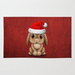 Cute Floppy Eared Baby Bunny Wearing a Santa Hat Rug