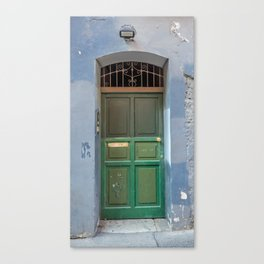 Wood green door in a medieval town Canvas Print