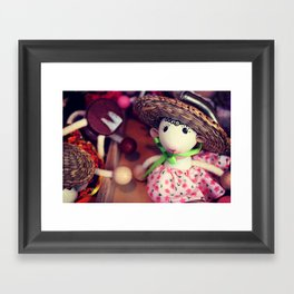 Wooden doll on the Christmas market Framed Art Print