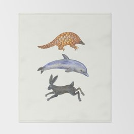 Pangolin, dolphin and a hare Throw Blanket
