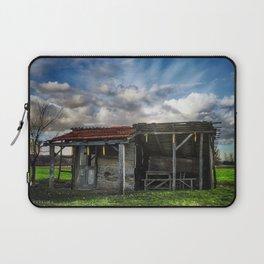 An old hut in a green field Laptop Sleeve