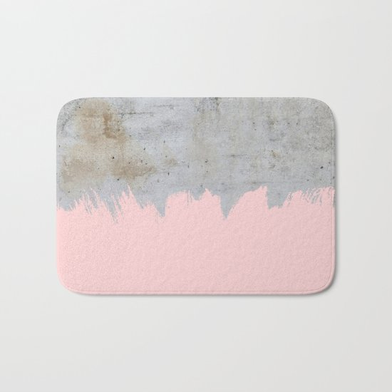 Paint with pink on concrete Bath Mat