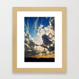 curious clouds Framed Art Print