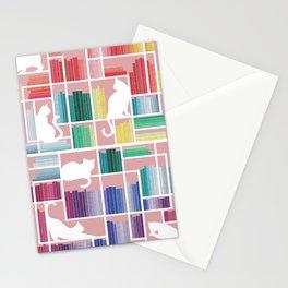 Rainbow bookshelf // blush pink background white shelf and library cats Stationery Cards