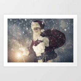 Santa Claus walking thru a winter snow storm to deliver Christmas Gifts Art Print
