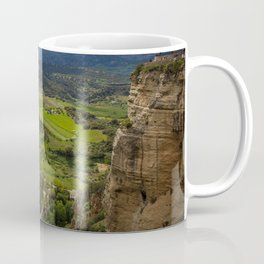 Cliffs in the city of Ronda, Spain. View of the field covered with clouds. Coffee Mug