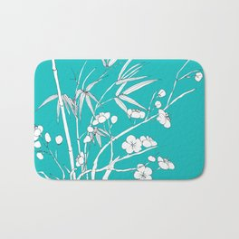 bamboo and plum flower white on blue Bath Mat