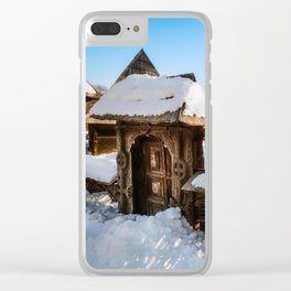 Traditional handcrafted gate and a rural Romanian homestead covered in snow Clear iPhone Case