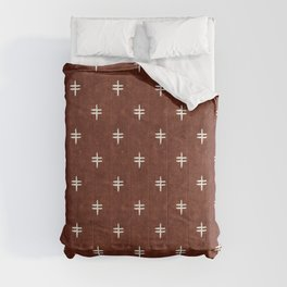 double cross on rust Comforters