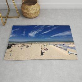 On the beach, blue sky Rug