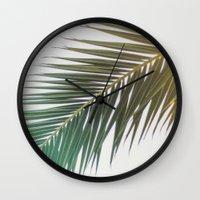 palm tree Wall Clocks featuring palm tree by iulia pironea