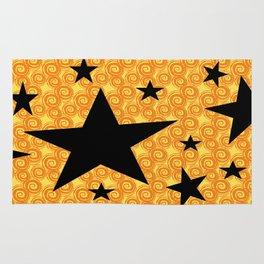 balck star and orange spiral Rug