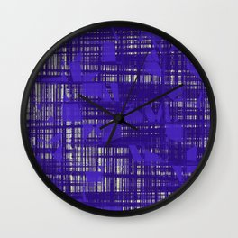 Blue random shapes hovering all over the blue messy lines above white background Wall Clock