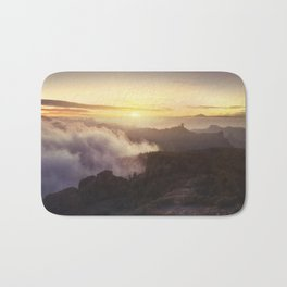 Sunset over the clouds Bath Mat