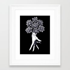 Hand with lotuses on black Framed Art Print
