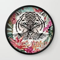 the thing Wall Clocks featuring WILD THING by Monika Strigel