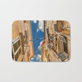 Looking up into the famous alleyways (kantounia) in the old town of Corfu, Greece Bath Mat