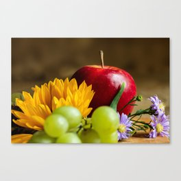 An autumn gifts still life on the blurred background Canvas Print