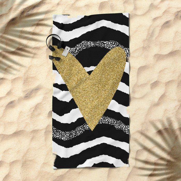 Heart on waves Beach Towel