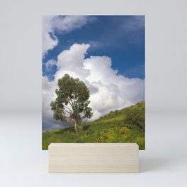 Solitary tree on a green hill Mini Art Print
