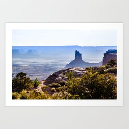 rocky butte at sunset in Utah badlands  Art Print