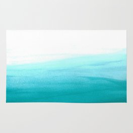 Ombre background in turquoise Rug