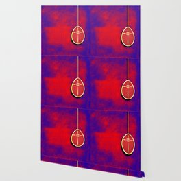 Gold cross in red egg hanging against a rich red and purple Wallpaper