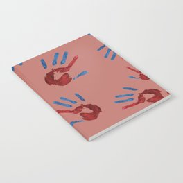 Red palm with blue fingers on dark pink Notebook