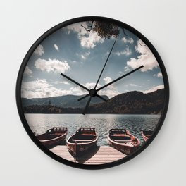 wooden boat at lake bled in the summer Wall Clock