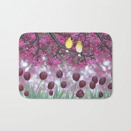 goldfinches, tulips, & flowering crabapple Bath Mat