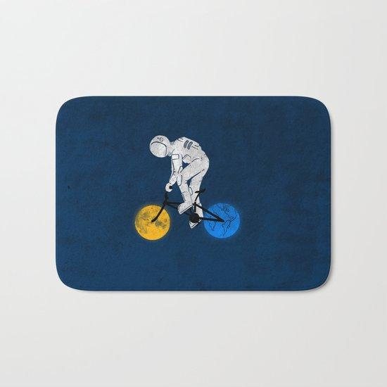 Astronaut on bicycle Bath Mat