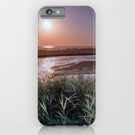 Minimal seascape with grass, sand and a river flowing into the sea. iPhone Case