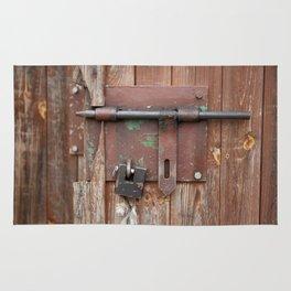 Iron sliding bolt unlocked and padlock Rug