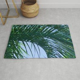 Exquisite, Curling Palm Leaf in Blue Sky Rug