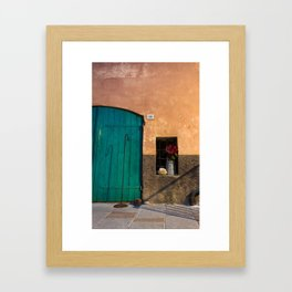 Part of a Tuscan wooden door with the typical bright colors Framed Art Print