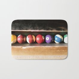 Group of vintage pool balls inside the table, closeup, retro style. Bath Mat